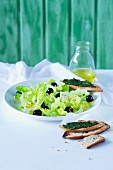 Lettuce with olives and a lemon dressing