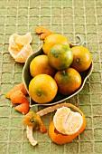 Mandarins in a leaf-shaped bowl