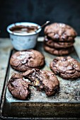 Chocolate cookies filled with caramel and soft nougat