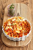 Pasta bake with tomatoes, mozzarella and parmesan