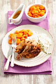 Lemon chicken with thyme, rice and carrots