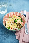 Farfalle with courgettes, peas and chilli