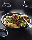 Pasta dish with meat and peas