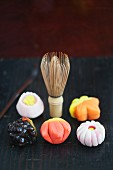Various wagashi (Japanese sweets) and a tea whisk