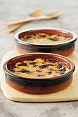 Crème brûlée in clay ramekins