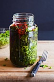 Homemade Pickled Mustard Greens in a Mason jar