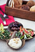 A plate of nibbles, with houmous, olives and salad (North Africa)