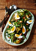 Roast potatoes with green beans and boiled eggs