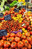 Various tomatoes on a market stand