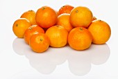 Several whole clementines
