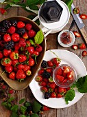 Strawberries and blackberries with a set of kitchen scales