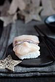 Nigiri sushi with bream (tai) and Christmas stars made from birch bark
