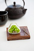 Wagashi pine (watsu) with a pot of tea (Japan)