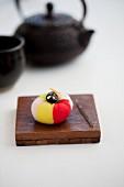 Wagashi camellia with a pot of tea (Japan)