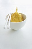 Tempura prawn in a bowl with chopsticks (Japan)