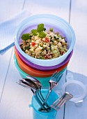 Couscous salad in a Tupperware container