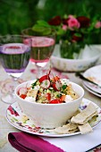 A mixed salad with radishes and feta cheese