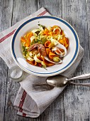Ribbon pasta with squash, venus clams and olives