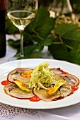Carpaccio of suckling pig with sweet and sour chilli cabbage