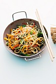 Asian noodles with colourful vegetables cooked in a wok