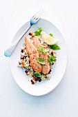 Salmon on couscous with pomegranate seeds