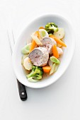 Poached pork fillet with leek, carrots and broccoli
