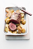 Roast fillet of beef with potatoes and garlic