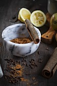 Chai spice mixture with cinnamon and cloves in a mortar