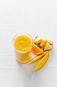 Smoothie with pineapple, orange and mango