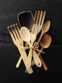 Assorted wooden spoons, frying spatulas and salad servers