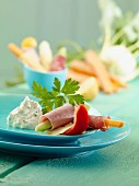 Rolled sliced of ham with vegetables and herb quark