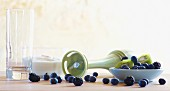 Still life featuring blueberries, kiwi and kitchen utensils
