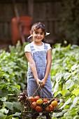 Girl holding basket of vegetables