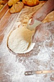 Bread dough on a floured wooden board