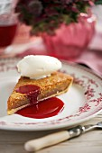 A slice of treacle tart with vanilla ice cream (England)