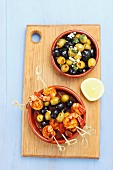 King prawn and olive skewers and marinated olives
