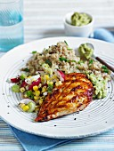 Spicy chicken breast with couscous and salsa