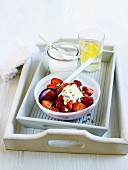 Red berry salad with plain yoghurt and pistachios