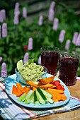 Guacamole and crudités on a table in the garden