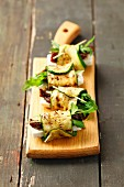 Grilled rolled slices of courgette filled with rocket, feta and sundried tomatoes