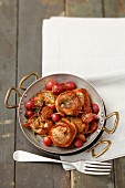 Roast pork fillet wrapped in bacon with grapes