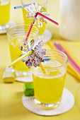 Flower shapes punched out of map decorating drinking straws for party