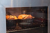 Two Bundt cakes in the oven
