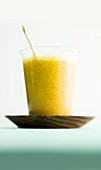 A mango and banana smoothie with curry