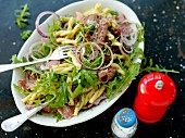 Pasta salad with salami and rocket