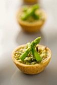 A mushroom tartlet with green asparagus