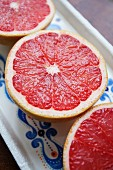Three pink grapefruit halves