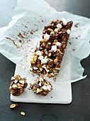 A chocolate bar with marshmallows and nuts