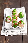 Quails eggs, cheese, ham and peppers in egg-shaped aspic