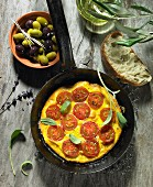 A tomato omelette with sage, black and green olives, olive oil, an olive spring, olive ciabatta and lavender